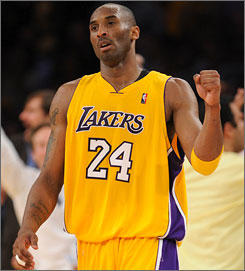 The Lakers' Kobe Bryant pumps his fist during the fourth quarter of Game 5 against the Nuggets. Bryant took just 13 shots and made eight assists as Los Angeles won to take a 3-2 series lead to Denver for Game 6.