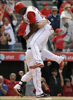 Los Angeles'       Gary Matthews Jr., top, jumps into the arms of teammate       Mike Napoli after scoring the winning run on a bases-loaded single by teammate       Kendry Morales in the ninth inning.