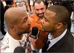 "Quinton ""Rampage"" Jackson and Rashad Evans stare down after UFC 96."