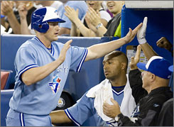 Lyle Overbay celebrates with his Blue Jays teammates after scoring in the fifth inning as Toronto ended its nine-game losing streak.