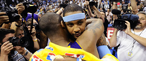 The Lakers' Kobe Bryant hugs the Nuggets' Carmelo Anthony (facing camera) after Los Angeles defeated Denver to advance to the NBA Finals.