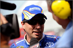 David Reutimann describes his qualifying run to the media after setting the fastest lap Friday at Dover.