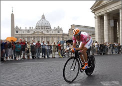 Russia's Denis Menchov makes his way past St. Peter's Basilica during the final stage of the Giro d'Italia.