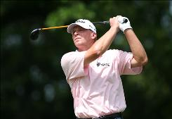 Steve Stricker, shown here on Saturday, birdied the second hole of a sudden-death playoff to win the Crowne Plaza Invitational on Sunday, edging out         Tim Clark and         Steve Marino after blowing a two-shot lead late in the round.