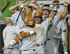 Texas first baseman Preston Clark, left, celebrates with Connor Rowe (10), Michael Torres (9) and Cole Green (behind Torres) after Rowe scored the winning run in the 25th inning against Boston College in the NCAA regionals in Austin, Texas.