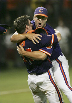 Clemson pitcher Matt Vaughn (22) celebrates with catcher John Nester (17) after Clemson defeated Oklahoma State to advance to the NCAA super regionals.