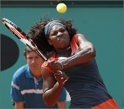 Serena Williams plays a shot during her fourth-round victory over Aleksandra Wozniak at Roland Garros on Monday.