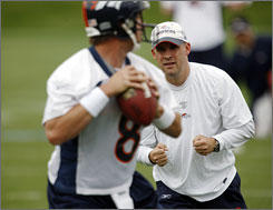 Broncos coach Josh McDaniels will choose between Kyle Orton (foreground) and Chris Simms as the team's starting quarterback for 2009.