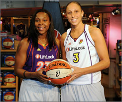 The Phoenix Mercury's Cappie Pondexter, left, and Diana Taurasi pose in the team's new jerseys at the NBA Store in New York on June 1.