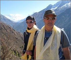 Johnny Strange, left, and his father Brian pause outside the village of Dingboche on the trek to base camp at Mount Everest. The two hope to complete the Seven Summits this week in Australia.
