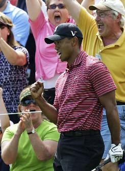 Tiger Woods shoots a celebratory fist pump after chipping in for eagle on the 11th hole in the final round in Dublin, Ohio. Woods birdied the last two holes to win the Memorial for the fourth time.