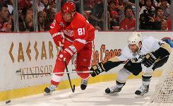 Pittsburgh's Rob Scuderi, right, shown battling for the puck against Detroit's Marian Hossa in Game 2, has helped the Penguins even the Stanley Cup series 2-2 with his defensive prowess.
