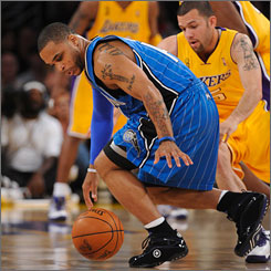 Magic guard Jameer Nelson tries to find the handle under pressure from L.A. defender Jordan Farmar during the first half of Game 1.