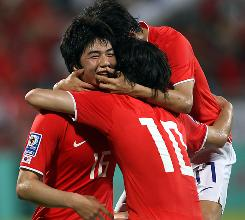 South Korea's players celebrate after scoring a goal Saturday against the United Arab Emirates.