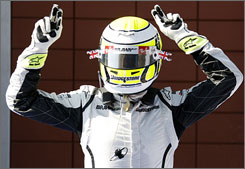 Jenson Button celebrates after taking the victory at the Turkish Grand Prix for his sixth Formula One win on the season.