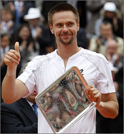 "Robin Soderling holds his runner-up trophy after losing to Roger Federer in the French Open championship match on Sunday.  ""Roger's game doesn't suit my game at all. He doesn't allow me to be aggressive. He always had me on the run today,"" Soderling said after the match."