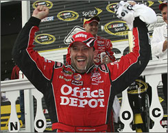 Tony Stewart soaks in his first points-paying win as a Sprint Cup owner/driver in Pocono Raceway's Victory Lane.