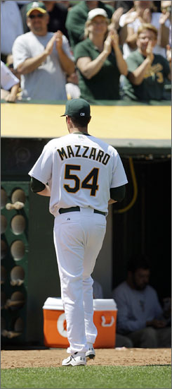 Vin Mazzaro gets a hand as he exits Oakland's eventual  win over Baltimore on Sunday. The righthander has not given up a run in the first 13 2/3 innings of his major league career.