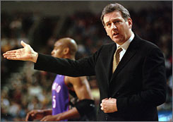 Paul Westphal questions a call during his last NBA head coaching job, with Seattle in 2000.