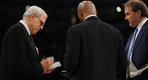 Lakers coach Phil Jackson draws up a play during Game 2 of the NBA Finals with assistants Brian Shaw, center, and Kurt Rambis. A series win would clinch Jackson's 10th NBA title and first since 2002.