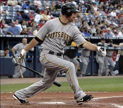 Pittsburgh Pirates' Adam LaRoche hits an RBI-single against the Atlanta Braves during the third inning Wednesday; his hit in the ninth-inning secured the win for the Pirates.