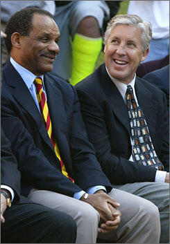 Southern California athletics director Mike Garrett, left, with football coach Pete Carroll in 2004, has had to parry criticism over payola accusations involving former Trojan athletes Reggie Bush and O.J. Mayo.