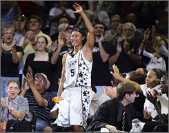 Vickie Johnson waves to the home crowd in 2007 after being recognized as the first WNBA player to record 3,000 points, 1,000 rebounds and 1,000 assists in a career.