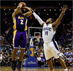 Derek Fisher of the Los Angeles Lakers makes a three-pointer over Jameer Nelson of the Orland Magic late in regulation of Game 4 of the NBA Finals on Thursday.