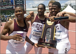 Texas A&M's 4x400 relay team (from left) Bryan Miller, Tran Howell, Kyle Dykhuizen and Justin Oliver celebrate with the NCAA championship trophy after scoring the clinching points in the men's meet.