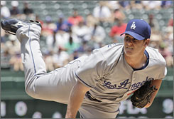 Dodgers starter Chad Billingsley earned his National League-leading ninth victory in the 6-3 win over the Rangers.