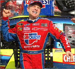 Mark Martin celebrates in Michigan International Speedway's Victory Lane after outlasting Jimmie Johnson and Greg Biffle for his third win of the year.