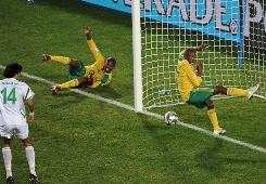 South Africa's Bernard Parker (17) accidentally blocks a shot from teammate Kagisho Dikgacoi late in Sunday's opening match of the Confederations Cup.