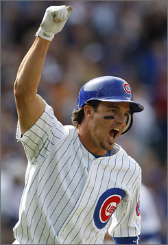 The Cubs' Ryan Theriot celebrates after hitting the game-winning single against the Twins in the bottom of the ninth.