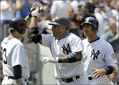 Yankees teammates congratulate Robinson Cano after he hits a home run.