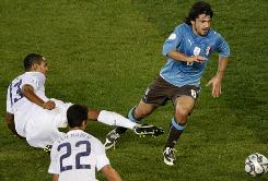 U.S. midfielder Ricardo Clark fouls Italy's Gennaro Gattuso in Monday's Confederations Cup game. Clark was given a red card on the first-half play, reducing the team to 10 men.