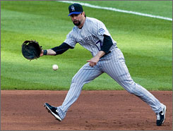 Todd Helton fields a grounder against St. Louis early this month. The first baseman and his Rockies teammates are riding an 11-game winning streak.