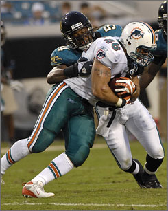Former Jaguars linebacker Mike Peterson, left, moved to an Atlanta suburb when he signed with the Falcons, only to discover that his new coach, Mike Smith, lives across the street.