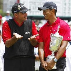 Rocco Mediate chats with a trophy-holding Tiger Woods after finishing second in the U.S. Open at Torrey Pines in 2008.