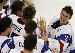 Jaroslav Janus, right, celebrates with his Slovakian teammates after a win over Team USA at the world junior hockey championships in early 2009. Janus is Red Line Report's seventh-rated goalie for this year's NHL draft.