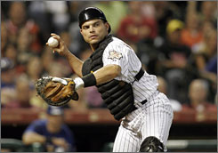 Astros catcher Ivan 'Pudge' Rodriguez caught his 2,226th career game Tuesday against Texas, tying the major league record held by Hall of Famer Carlton Fisk.