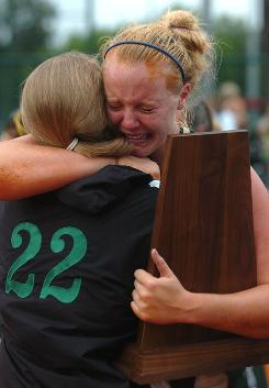 Speake pitcher Kylie Black is overcome afterthe school won the Alabama 1A softball title May 16, the team's last softball game before the school closed.