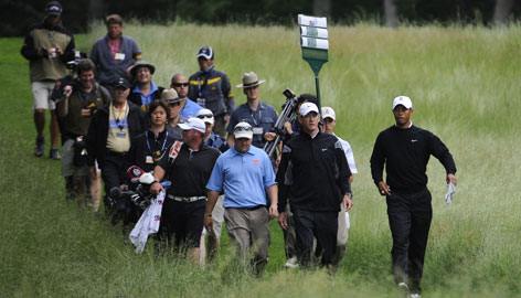 Tiger Woods has plenty of company as he plays a practice round Tuesday on the Black Course at Bethpage State Park, the site of this week's U.S. Open.