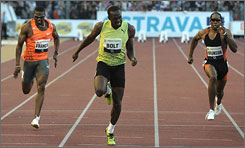 Usain Bolt runs to the finish in a 100 meter race Wednesday at the Golden Spikes meet in the Czech Republic. Bolt ran a wind-aided 9.77, just off his world record time of 9.69.