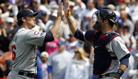 "Twins closer Joe Nathan, left, praises Joe Mauer's defensive contributions. ""He stops running games,"" Nathan says. ""He can worry about the running game himself."""
