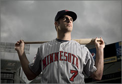 Minnesota Twins catcher Joe Mauer, long an accomplished hitter, has added power to his game this season.