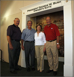 Texas Rangers President and Hall of Fame pitcher Nolan Ryan, former President George W. Bush, former First Lady Laura Bush and Rangers team owner Tom Hicks pose in front of the owner's suite that was renamed after Bush.