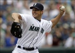Seattle Mariners pitcher     Erik Bedard, shown here against the Minnesota Twins on June 7, is expected to return back to the rotation in two weeks following shoulder inflammation.