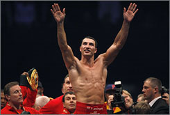 Wladimir Klitschko celebrates after defeating Ruslan Chagaev to retain the IBF and WBO heavyweight titles.