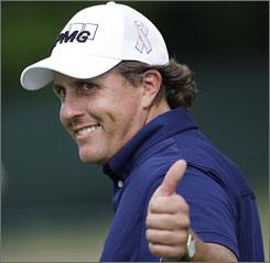 Phil Mickelson gives a thumbs-up during his second round of play at the U.S. Open in Farmingdale, N.Y. Mickelson carded an even-par 70 in the round to remain at 1-under par overall.