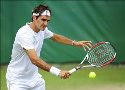 Switzerland's Roger Federer, shown here at a practice session in London on Sunday, looks to break Pete Sampras' record of 14 Grand Slam titles when he takes the court in the opening round of Wimbledon on Monday morning.